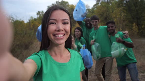 Thumbnail for Happy Diverse Team of Volunteers Posing for Selfie