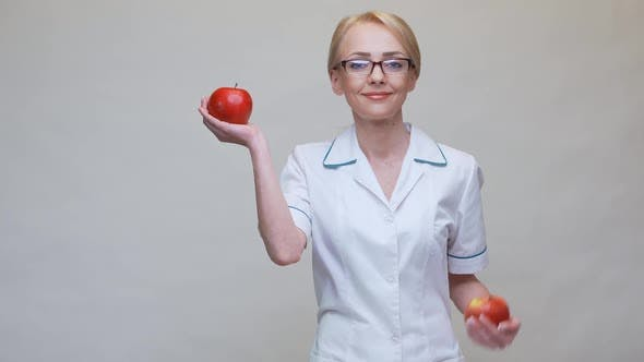 Thumbnail for Nutritionist Doctor Healthy Lifestyle Concept - Holding Organic Red Apple