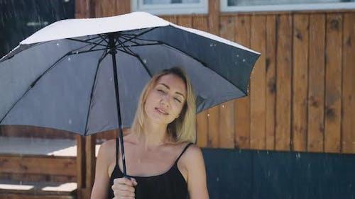 Attractive Blonde in the Summer Rain