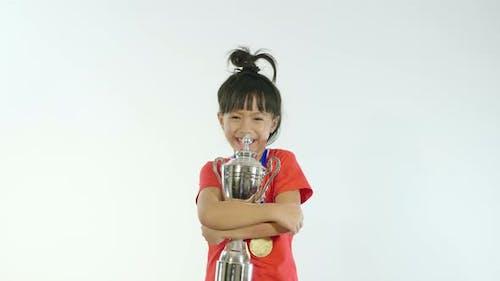 Little Girl Hugging Her Trophy