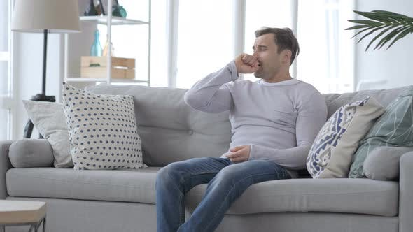 Thumbnail for Coughing Sick Adult Man Sitting on Couch, Cough