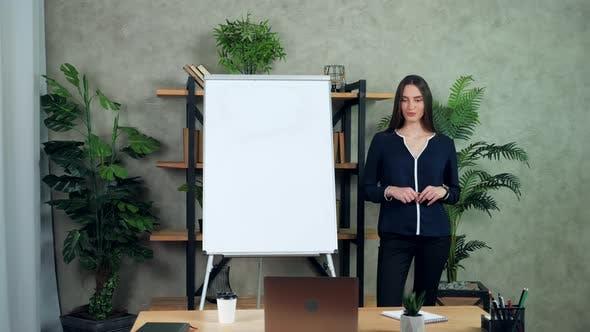 Businesswoman coach greets listen talk teaches students online video call laptop