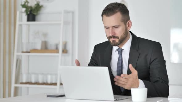 Shocked Businessman Working on Laptop, Astonished