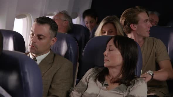 Thumbnail for Woman trying to sleep on airplane flight