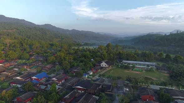 Thumbnail for Flying over Village in Doi Inthanon at Sunrise