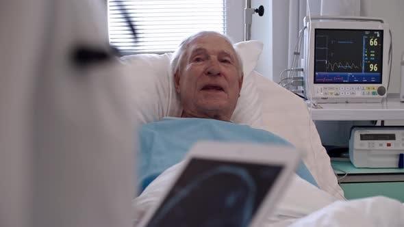 Thumbnail for Senior Man Talking to Healthcare Worker