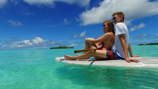 Thumbnail for Romantic lady and man on honeymoon vacation enjoy luxury on beach on summer white sandy background