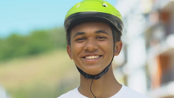 Thumbnail for Teen Boy In Bicycle Helmet Smiling