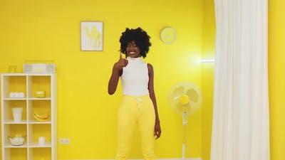 Portrait of Black Stylish Model Showing Thumb Up Sign