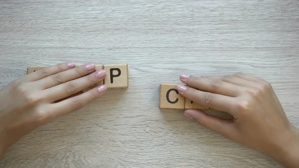 Thumbnail for Keep Calm, Hands Pushing Words on Wooden Cubes, Positive Thinking and Motivation