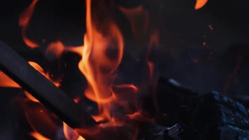 The fire burns in the fireplace, heating house with wood concept