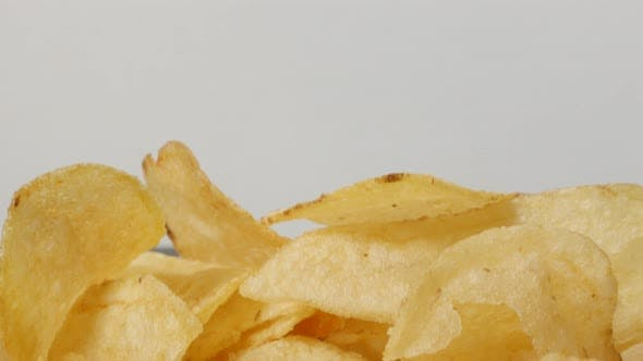 Slices of fried potato chips  for youth in a bowl popular appetizer 4K 3840X2160 UltraHD footage - V