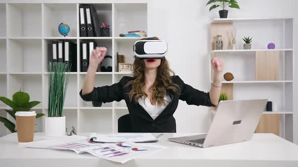 Thumbnail for Businesswoman Working on Imaginary Screen Using Augmented Reality Glasses