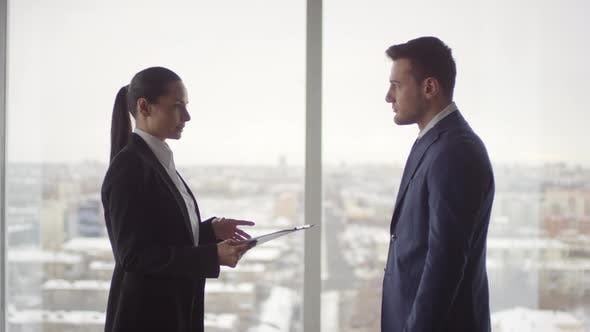 Thumbnail for Female Executive Discussing Business with Businessman