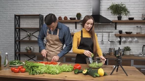 Food Blogging Young Woman Talking About Salad Preparing Process and Filming the Whole Process with a