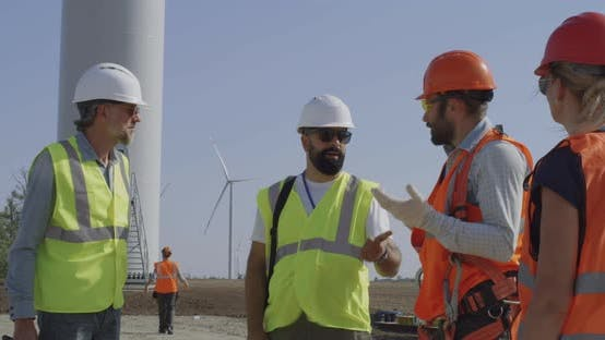 Thumbnail for Engineers Inspecting Construction Site Near Windmill