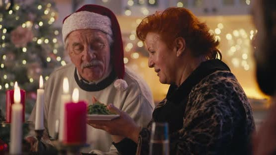 Elderly Parents with Family During Christmas Dinner