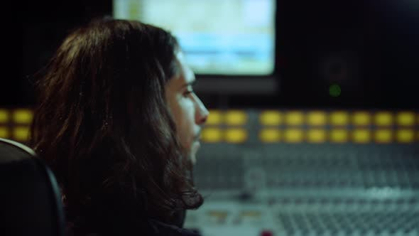 Composer Turning on Chair in Studio. Sound Engineer Listening Music Indoor