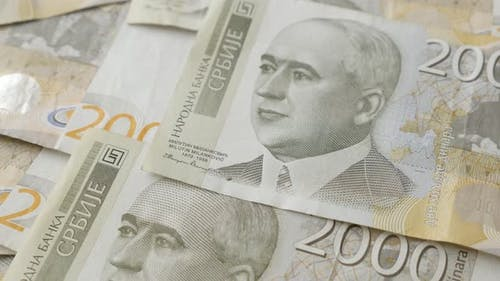 Rows of two thousand Serbian dinar denominations close-up  4K 2160p 30fps UltraHD tilting footage -