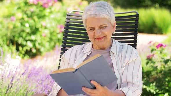 Thumbnail for Happy Senior Woman Reading Book at Summer Garden