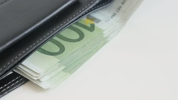 Thumbnail for Money in black leather wallet 3840X2160 UltraHD tilting footage - Banknotes of Euro in bi-fold money