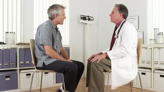 Thumbnail for Senior doctor talking to mature patient