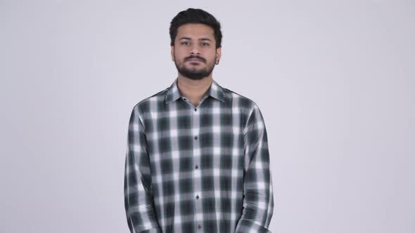 Thumbnail for Portrait of Young Handsome Bearded Indian Man with Arms Crossed