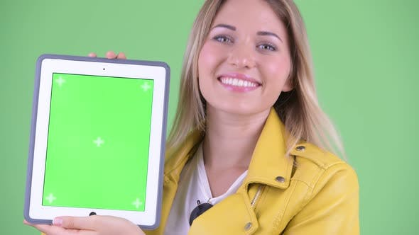 Thumbnail for Face of Happy Young Rebellious Blonde Woman Showing Digital Tablet