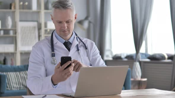 Thumbnail for Doctor Using Smartphone for Internet