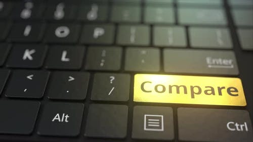 Black Computer Keyboard and Gold Compare Key