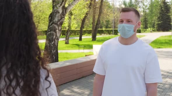 Thumbnail for Man and Woman Having Conversation Outdoors during Pandemic