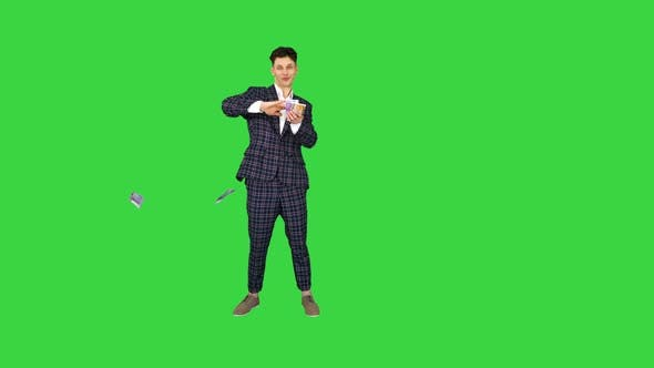 Thumbnail for Wealthy Businessman Throwing Money in Air on a Green Screen, Chroma Key.