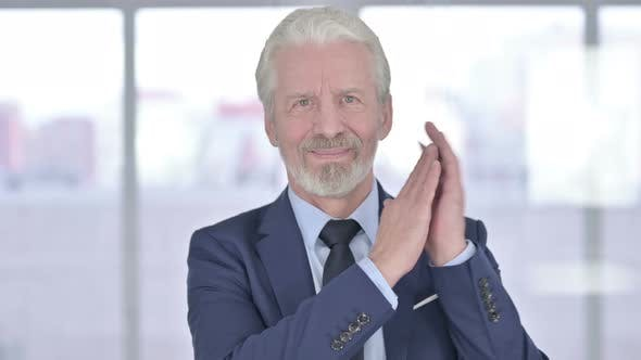 Thumbnail for Clapping Old Businessman