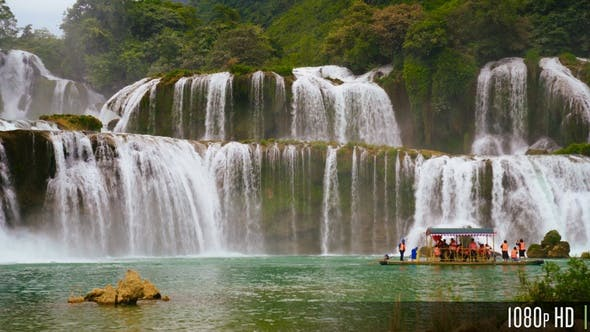 Thumbnail for Panoramic Ban Gioc Waterfall In Vietnam With Boat of Tourists