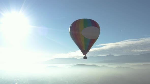 Baloon Flying Over The Clouds
