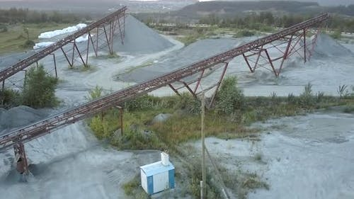 Brown Rusty Supports at Power Lines and Rubble Barrows