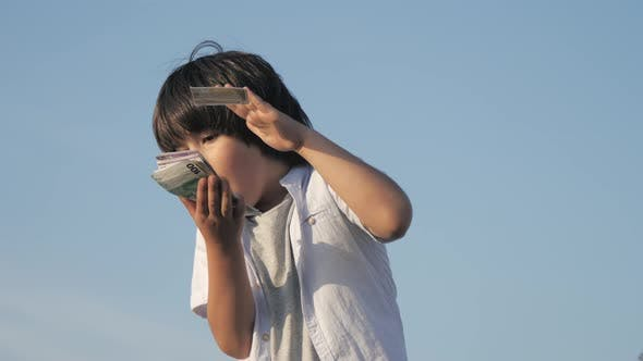 Thumbnail for Cute Boy Throwing Money Euro Banknotes.