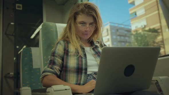 Young Woman Work Laptop When Commute By Train