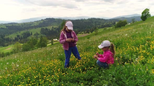 Thumbnail for Children Playing on a Flowering Lawn Against the Backdrop of the Carpathian Mountains