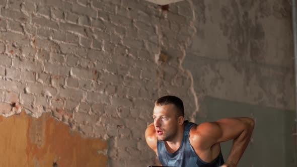 Thumbnail for Man Doing Triceps Dip on Parallel Bars in Gym