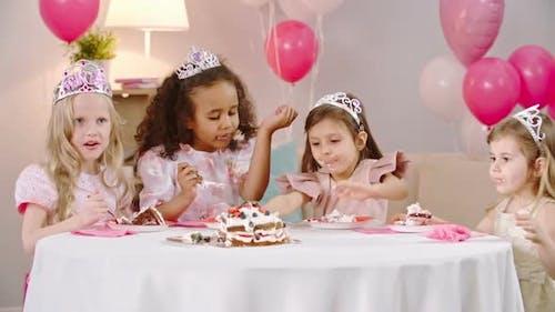 Sweet Princesses Eating Birthday Cake