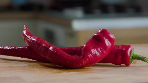 Red Hot Pepper On the Table In Kitchen In House