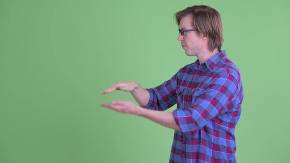Thumbnail for Happy Young Handsome Hipster Man Snapping Fingers and Showing Something