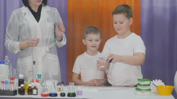 Thumbnail for Chemical Experiments for Children. Fun Experiments for Children. Woman Makes Magic Movements with