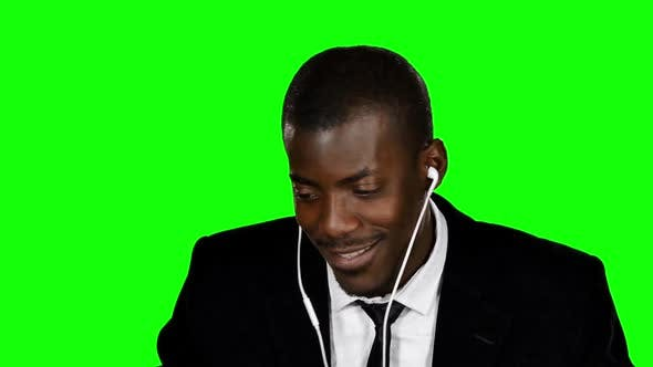 Thumbnail for Happy Businessman Listening To Music. Green Screen
