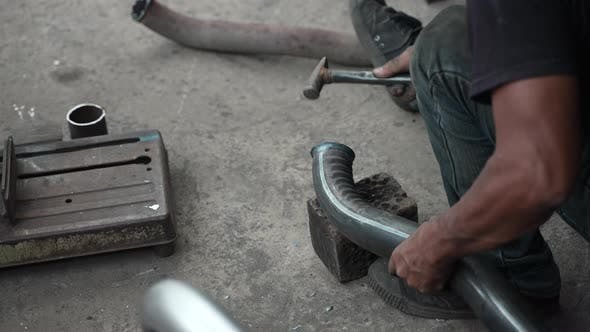 blacksmith welder works with metal steel and iron using a welding machine, bright sparks and flashes