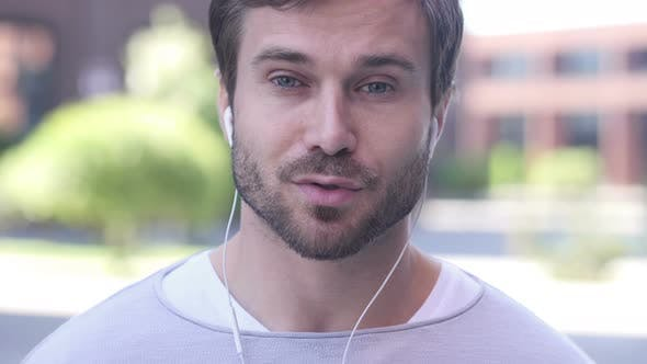 Cover Image for Online Video Chat by Man Standing Outside Office, Talking