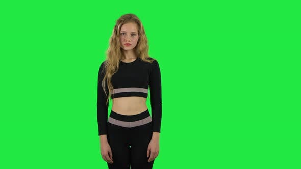 Cover Image for Blonde Girl Posing at the Camera. Green Screen