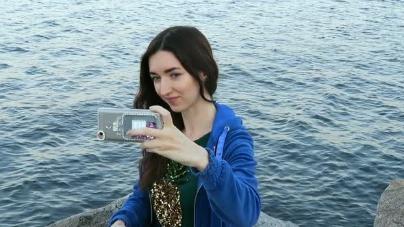 Thumbnail for Girl Makes Selfie On The Background Of The Sea 2