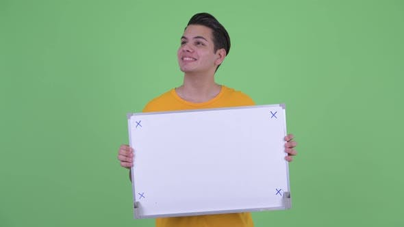 Thumbnail for Happy Young Multi Ethnic Man Thinking While Holding White Board